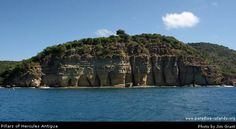 Antigua. The Pillars of Hercules stand at the end of Charlotte Point guarding the entrance to Freeman's Bay and English Harbour. These are natural geological rock formations carved by wind, rain and the sea. Unfortunately they can only really be appreciated when viewed from the sea.