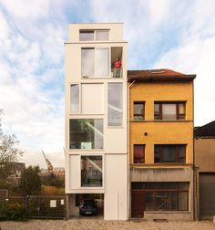 Gallery of house BRZ / P8 architecten | 1:100 | Vertical House Shape | House Typ | Urban House | Between Building | Flat Land | more than 3 levels | all white | front facade house |