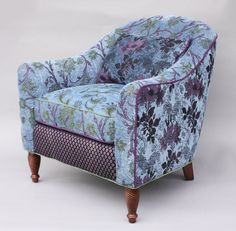 Julia Chair in Blue Lavender by Mary Lynn O'Shea. The artist's own *jacquard* color combinations bring vibrance and verve to her double-cloth cotton and rayon fabric. Kiln-dried hardwood frame with double doweled joints and blocked corners. Hand-tied deep seating coils tied in 8 directions. Spring-down cushions offer strength and comfort.