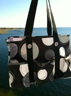 Thirty One Organizing Utility Tote  7 pocket canvas tote perfect for running errands, use a mobile office, baby diaper bag, gym bag, scrapbooking, shopping, use as a gift bag, take it the beach and more! Selection of prints available. www.mythirtyone.com/KerryClark