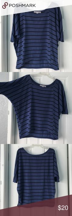 Striped Blue Blouse This striped blue blouse is perfect for any kind of day! It is a size small and is 65% polyester and 35% rayon. The sleeves go to above your elbow and the top is not form fitting and so it is flowing especially around the armpit. It's longer in the back than the front to make this top a high low blouse. There is a small stain on the tag of the shirt but that's not noticeable when you're wearing it. Let me know if you're interested! Love By Design Tops Blouses