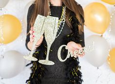 New Year's-themed champagne glasses and Cheers! photo prop set