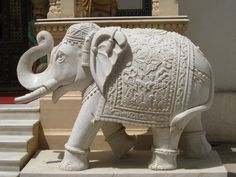 A elephant, beautifully hand carved out of white marble at a local stone mason's store in Jaipur, India.