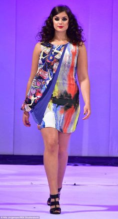 Keeping it real: A model sashays down the catwalk at UK Plus-Size Fashion Week...
