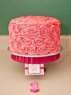 Rose swirl cake...for wedding, creme colored, edible sparkle (clear glitter) and crystal initial topper!