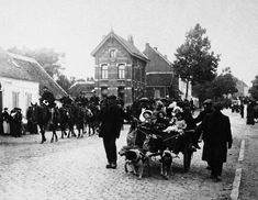 In this October 14, 1914, file photo, Belgian civilians and a cavalry detail move out of the pathway of the German advance during World War I in Antwerp, Belgium.