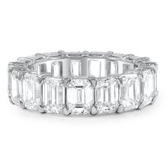 Seventeen emerald cut diamonds encircle this wedding band in an eternity style. The shared claw prong settings and open gallery of each stone adds to the beauty of this piece.