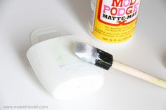 Holder for Charging Cell Phone (made from lotion bottle)   Make It and Love It