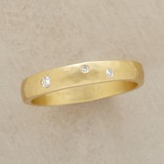 TRIO OF STARS RING--Echoing the three stars of Orion's belt, the glittering jewels in Sarah McGuire's diamond stars gold ring are equally heavenly. Handcrafted in USA of matte 18kt gold. .05 approximate total carat weight. Whole and half sizes 5 to 8.