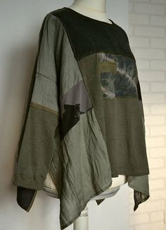 Patchwork poncho/ cape, loose tunic top. Poncho with long sleeves. Color : shades gray and shades dark green Size : oversize