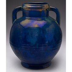"""Exceptional Pewabic vase large and unusual double handled shape covered in a very good blue, green and gold metallic glaze, marked, 9""""w x 10.5""""h"""