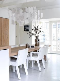 Wooden table connected to the kitchen island