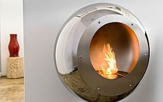 Vellum – the stainless steel round wall mount fireplace in mirror finish by Cocoon Fires