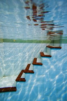Underwater stairs in swimming pool how cool, but I would swim into them.