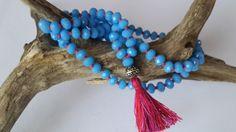 Cornflower blue Swarovski Mala. Contains 108 beads.