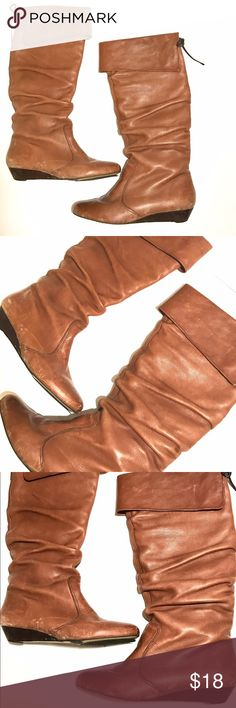 Brown wedged boots Size 9, true to size. Flaw: marks at the bottom of the shoes reflects on price. Still have some life to them. Aldo Shoes Heeled Boots
