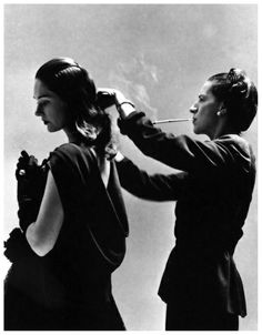 Always with a cigarette, this photo is iconic. Diana Vreeland for Harpers Bazaar 1946 by Richard Avedon.    (Diana Vreeland (July 29, 1903, Paris, – August 22, 1989, New York City) was a noted columnist and editor in the field of fashion. She worked for the fashion magazines Harper's Bazaar and Vogue and the Costume Institute of the Metropolitan Museum of Art. She was named to the International Best Dressed List Hall of Fame in 1965.)