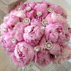 This embellished with broaches given from each bridesmaid, mother-in-law and…