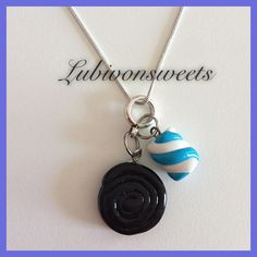 Polymer clay Licorice wheel & marshmallow necklace.
