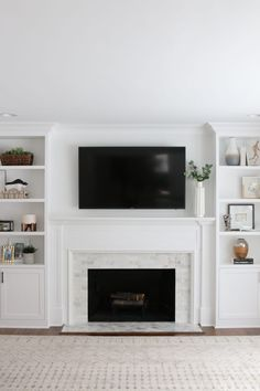 Looking to update your old fireplace? This step-by-step process takes you through how we transformed our old fireplace into a white marble tile fireplace that we absolutely love. Built In Around Fireplace, Fireplace Tile, Fireplace Design, Living Room With Fireplace, Fireplace Bookshelves, Fireplace Remodel, White Marble Tiles, Fireplace, Fireplace Built Ins