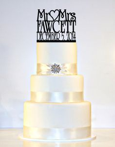 """Monogram Wedding Cake Topper personalized with """"Mr & Mrs"""" and YOUR Last Name and Wedding Date on Etsy, $35.00"""