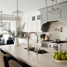 Gray Wood Range Hood with White Shaker Cabinets