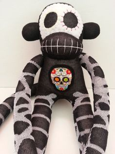 I just can't get enough of these Munkys!!! Sugar Skull Sock Monkey by MunkybunsSockToys on Etsy, $35.00