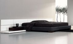 Black and white bedroom, Boiserie bed by Italian brand Pianca _....http://www.pinterest.com/codeplusform/paris-je-taime/