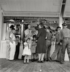 """Good Popcorn: 1942  August 1942. """"Butte, Montana. Children are transported to Columbia Gardens, an outdoor amusement resort, every Thursday during the summer by city buses."""" Via Shorpy. Medium-format nitrate negative by Russell Lee."""