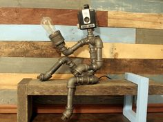 A personal favorite from my Etsy shop https://www.etsy.com/listing/237365234/robot-lamp-pipe-lamp-industrial-decor