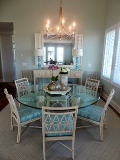 This beach house dining room is light and airy, yet grounded by a fabulous HomeGoods centerpiece compiled of a mercury glass lantern florals and beautiful wooden tray. Sponsored HomeGoods HappybyDesign