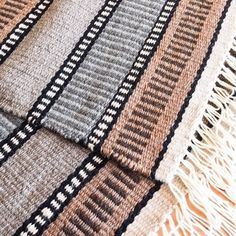 """Pic is just for pretty - Rag rugs """"I don't hem them until after they are washed. I've learned to use 2 strands of the rug warp together for the hem weft so it shrinks less because I'm able to beat it more firmly. But the hem does shrink in that initial wash, so don't sew it until after it's done it's shrinking. """""""