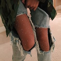 Sparkle fishnet tights layered under distressed denim for an alternative NYE outfit Pinterest: KarinaCamerino