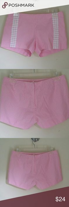 """Lilly Pulitzer size 00 seersucker shorts Really cute and very good condition. Zip and button in the back. Cotton and polyester.  The waist is 15"""" across.    7 """" from the waist to the hem. Lilly Pulitzer Shorts"""