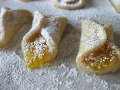 Polish kolaczki ~ Just cream cheese, flour and butter. The sweetness comes from the jam and the pretty powdered sugar on top.