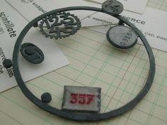 Nicola Becci Numbers brooch 01  oxidised silver,cold enamel,paper,vintage laundry tape,vintage number tacks