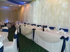 This simple swagging gives a plain top table presence in the room.