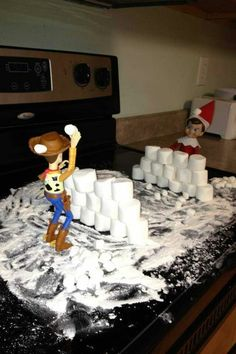 Elf on the shelf idea - fun (but do I want to clean all that up in the morning?!?!)