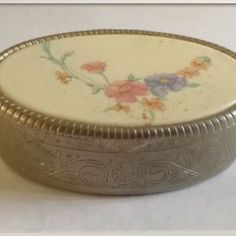 Early 1900's - Beige & flower motif Pill Box with detailed engraved silver casing   Dimensions : +/- 70mm x 50mm x 54mm Weight - +/- 61g