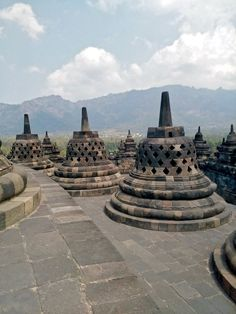 """Approximately 40 kilometres (25 mi) northwest of Yogyakarta and 86 kilometres (53 mi) west of Surakarta, Borobudur is located in an elevated area between two twin volcanoes, Sundoro-Sumbing and Merbabu-Merapi, and two rivers, the Progo and the Elo. According to local myth, the area known as Kedu Plain is a Javanese """"sacred"""" place and has been dubbed """"the garden of Java"""" due to its high agricultural fertility. (Wikipedia)  #Indonesia Surakarta, Two Rivers, Borobudur, Javanese, Yogyakarta, Volcanoes, Burj Khalifa, Fertility, North West"""