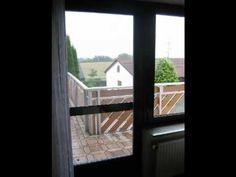 Alte Balkontür und Fenster aus Holz und neue Balkontür und Fenster aus Kunststoff in Holzoptik ------- old door and window of wood and new door and window of pvc in wood optic