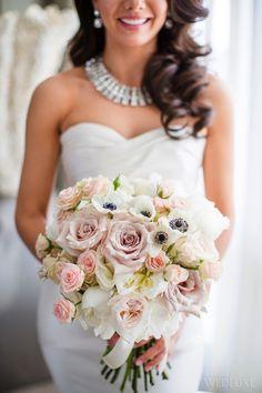 We love this stunning blush bouquet by Rachel A Clingen. | Photography: Ikonica |  #fourseasons #Toronto #weddings #fsweddings #bridal #springwedding #spring #florals