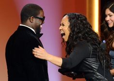 """""""Can you believe this?"""" Husband and wife Erica and Warryn Campbell accept their GRAMMY for Best Gospel Song for """"Go Get It"""" at the 55th GRAMMY Awards in 2013"""
