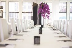 Communal table - simple, modern with a pop of color - corporate event inspiration