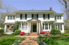 I want a house like this, with beautiful flowers out front, pillars at the entrance of the house, and side porch! BEAUTIFUL!!