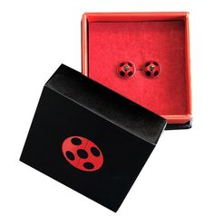 """Pre-Order! Shipping 7-14 days You can also be like Marinette and turn into Ladybug with your very own Miraculous earrings. These earrings are the perfect finishing touch for your Miraculous cosplay or make the perfect gift for any fan. Bye-bye, little butterfly! Sterling Silver """"Miraculous"""" Symbol ZAG engraving Metall"""