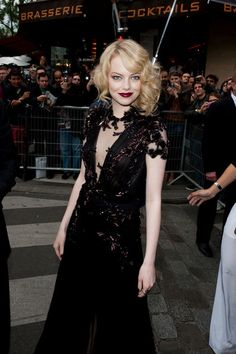 Emma Stone attends the French premiere of the movie 'The Amazing Spider-Man' held at Le Grand Rex Cinema on June 19, 2012. The newly-blonde starlet opts for a dramatic look with dark red lipstick and a plunging black dress with a thigh-high slit.
