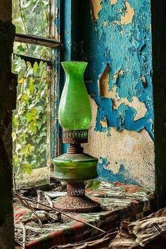 We'll keep the light on for you. Decadent decay, peeling paint, Green oil lamp found on a window sill in an abandoned cottage in the Republic of Ireland. Abandoned Houses, Abandoned Places, Peeling Paint, Window View, Old Doors, Oil Lamps, Belle Photo, Painting Inspiration, Still Life