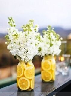 These bright, fresh centerpieces not only look beautiful but also give off a citrusy scent. Slice lemons (or any other citrus fruit you'd like such as grapefruit) and put them in the vase with flowers and water to keep them from wilting throughout the day.