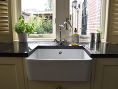 Our new house: the kitchen sink - Anne Travel Foodie Me & Mats Green Kitchen, Kitchen Sink, New Kitchen, Small Stove, Yellow Tile, Wooden Shutters, Kitchen Stories, Cabinet Space, Foodie Travel